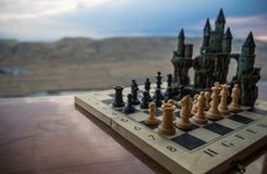 Chess board game concept of business ideas and competition. Chess figures on a chessboard. Outdoor sunset background. Chess board game concept of business ideas royalty free stock photography
