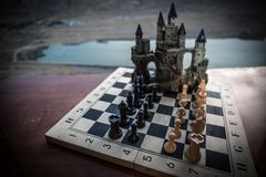Chess board game concept of business ideas and competition. Chess figures on a chessboard. Outdoor sunset background. Chess board game concept of business ideas royalty free stock photos