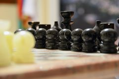 Chess board game concept of business ideas and competition and strategy ideas concep. Chess figures on a dark background with smok stock photography