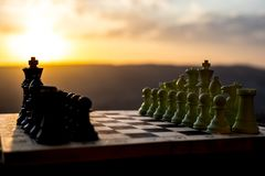 chess board game concept of business ideas and competition and strategy ideas. Chess figures on a chessboard outdoor sunset backgr stock photography