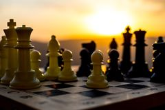 chess board game concept of business ideas and competition and strategy ideas. Chess figures on a chessboard outdoor sunset backgr royalty free stock photos
