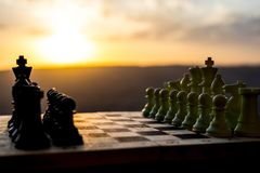 Chess board game concept of business ideas and competition and strategy ideas. Chess figures on a chessboard outdoor sunset backgr. Ound. Selective focus stock images