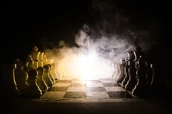 Chess board game concept of business ideas and competition and strategy ideas concep. Chess figures on a dark background with smok. E and fog. Selective focus stock image