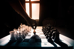 chess board game concept of business ideas and competition and strategy ideas concep. Chess figures on a dark background with smok Stock Photos