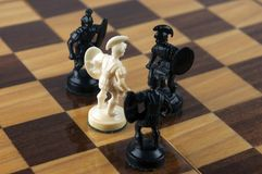 Chess board game concept of power and bravery. White pawn against a black pawns. Selective focus on white pawn. Concept of One against all. Concept of power and Royalty Free Stock Photography