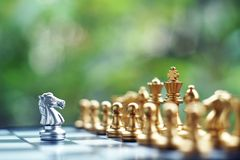 Chess board game. Fighting between silver and golden team. Business competitive and strategy planning concept. Chess board game. Fighting between silver and stock image