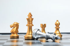 Chess board game gold player killed silver king for business com Royalty Free Stock Photo
