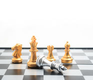 Chess board game gold player killed silver king for business com Stock Photo