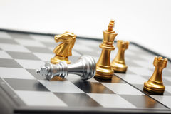 Chess board game gold player killed silver king for business com Stock Image