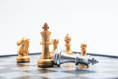 Chess board game gold player killed silver king for business com Royalty Free Stock Image