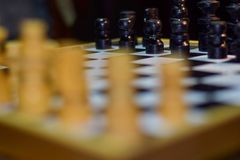 Chess board game for ideas and competition and strategy Soft focus on a wooden table royalty free stock photos