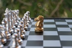 Chess board game. A knight faces all the enemies. Leader with courage concept. Chess board game. A knight faces all the enemies team. Leadership with courage stock photography