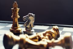 Chess board game. Last knight stand. Winner and leadership concept. Business successful concept stock photo