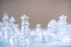 Chess board game made of glass, business competitive concept royalty free stock photos