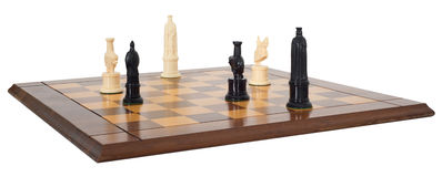 Chess Board Game and Pieces, Isolated. A chessboard and chess pieces. The board is made of wood. The game is isolated on white. Chess is a game of strategy Stock Photography
