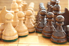 Chess. Board game chess at wooden chessboard stock images