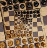 Abstract wooden chess board desk white black figures square spiral surreal effect. Pattern effect Surreal chess board desk fractal Royalty Free Stock Images