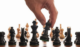 Chess board and hand Stock Photo