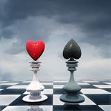 Chess. A chess board with  Heart-figure and Suit-figure Royalty Free Stock Photo