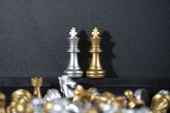 Gold and Blond King Chess and another chess on the black backgro. Chess board is the intelligence strategy game to make ideas for business and marketing concept stock photo