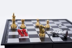 Chess Board isolated on white background. Golden and silver figures stock images