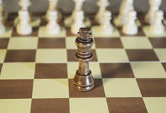Chess Board - King facing enemies. Chess Board - King facing enemies all alone royalty free stock photos
