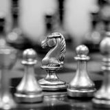 Chess Board with Knight Facing Opponent Stock Image