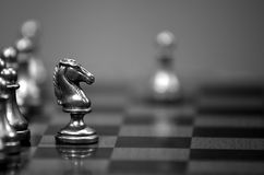 Chess Board with Knight Facing Opponent Stock Photography