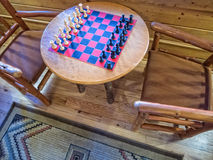 Chess board at the lodge. Chess board is ready for some fun Royalty Free Stock Image