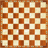 Chess board. Luxury carved in wood checkered chess board Royalty Free Stock Photography