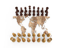 Chess board out of a dry world map with chess play Stock Photos