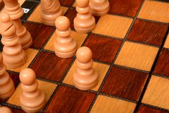 Chess Board and Pawns - Win the Game concept.  Stock Photos