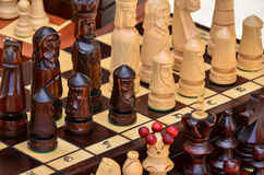 Chess board and pieces made from wood Stock Images