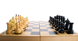 Chess board and pieces in start position. Isolated on white Stock Images