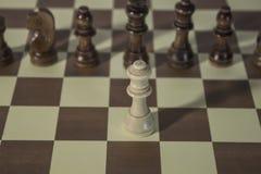 Chess Board - Queen facing enemies. Chess Board - Queen facing enemies all alone stock images