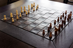 Chess on a board. Ready to play chess on a board With the light coming from behind stock photos