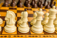 Chess board with starting positions aligned chess pieces Stock Photo