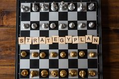 Chess board and text `Strategic plan` Business planning concept.  royalty free stock photography