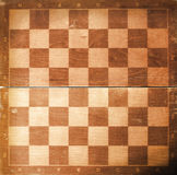 Chess board texture. Old chess board texture background stock image