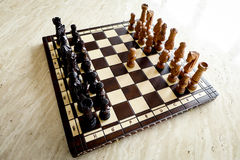Chess board on travertin floor. Beautiful chess board on the stone floor Royalty Free Stock Image