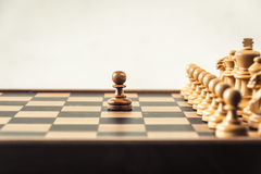 Chess on board  white background. Confrontation concept. Chess on board white background. Confrontation concept Royalty Free Stock Photos