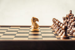 Chess on board  white background. Confrontation concept. Chess on board white background. Confrontation concept Stock Images