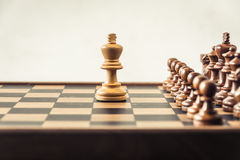 Chess on board  white background. Confrontation concept Royalty Free Stock Images