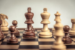 Chess on board  white background. Confrontation concept Royalty Free Stock Photography