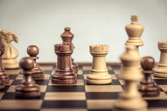 Chess on board  white background. Confrontation concept. Chess on board white background. Confrontation concept Stock Photography