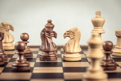 Chess on board  white background. Confrontation concept. Chess on board white background. Confrontation concept Stock Photos