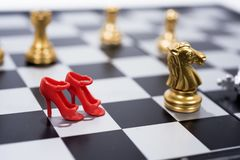 Chess Board on white background. Golden and silver figures stock image