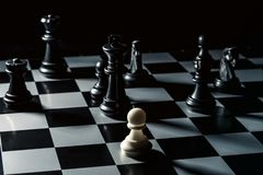 Chess board. White checker threatens the black chess opponent stock images