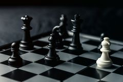 Chess board. White Elephant threatens black opponent`s chess. Horizontal frame royalty free stock photography