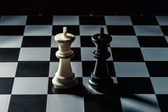 Chess board. White king threatens black opponent`s king royalty free stock image